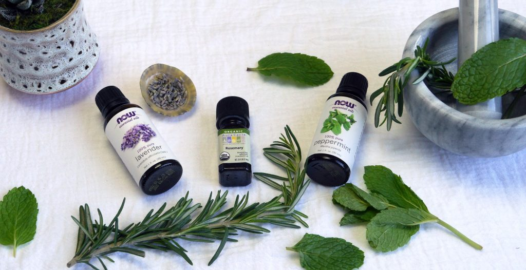 lavender essential oil, rosemary essential oil, peppermint essential oil, mortar and pestle, fresh herbs