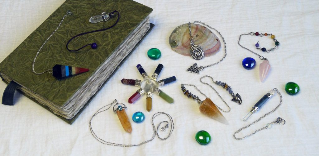 assortment of pendulums, crystal pendulum, silver pendulum, simple pendulum