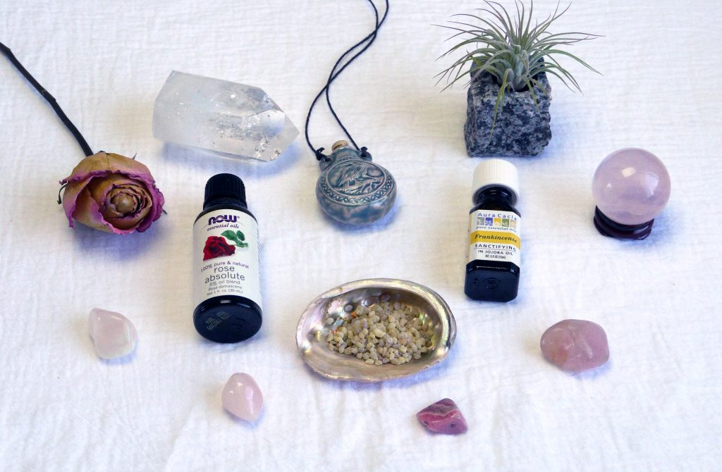 rose absolute essential oil, frankincense essential oil, frankincense resin, dried rose, quartz crystal, rose quartz