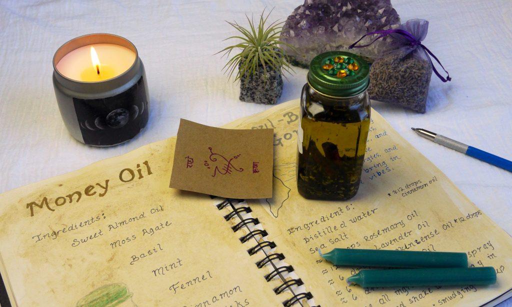 Sigil, spell, spell book, candle, magickal oil, amethyst crystal.