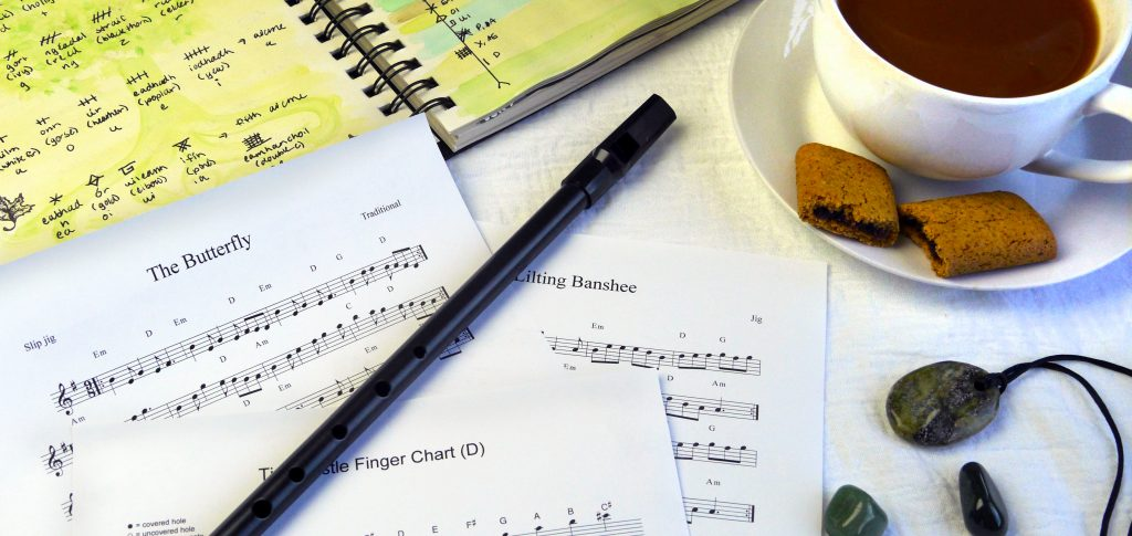 tin whistle, sheet music, irish music, and ogham