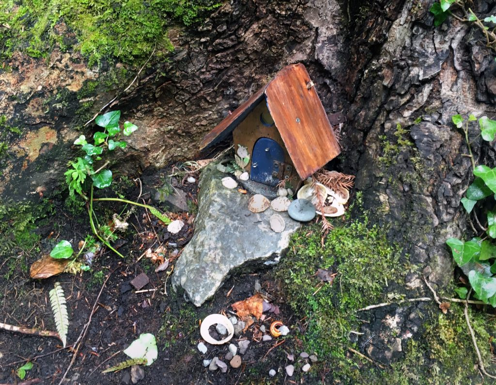 fairy house surrounded by offerings to the faeries in Derrynane, Ireland