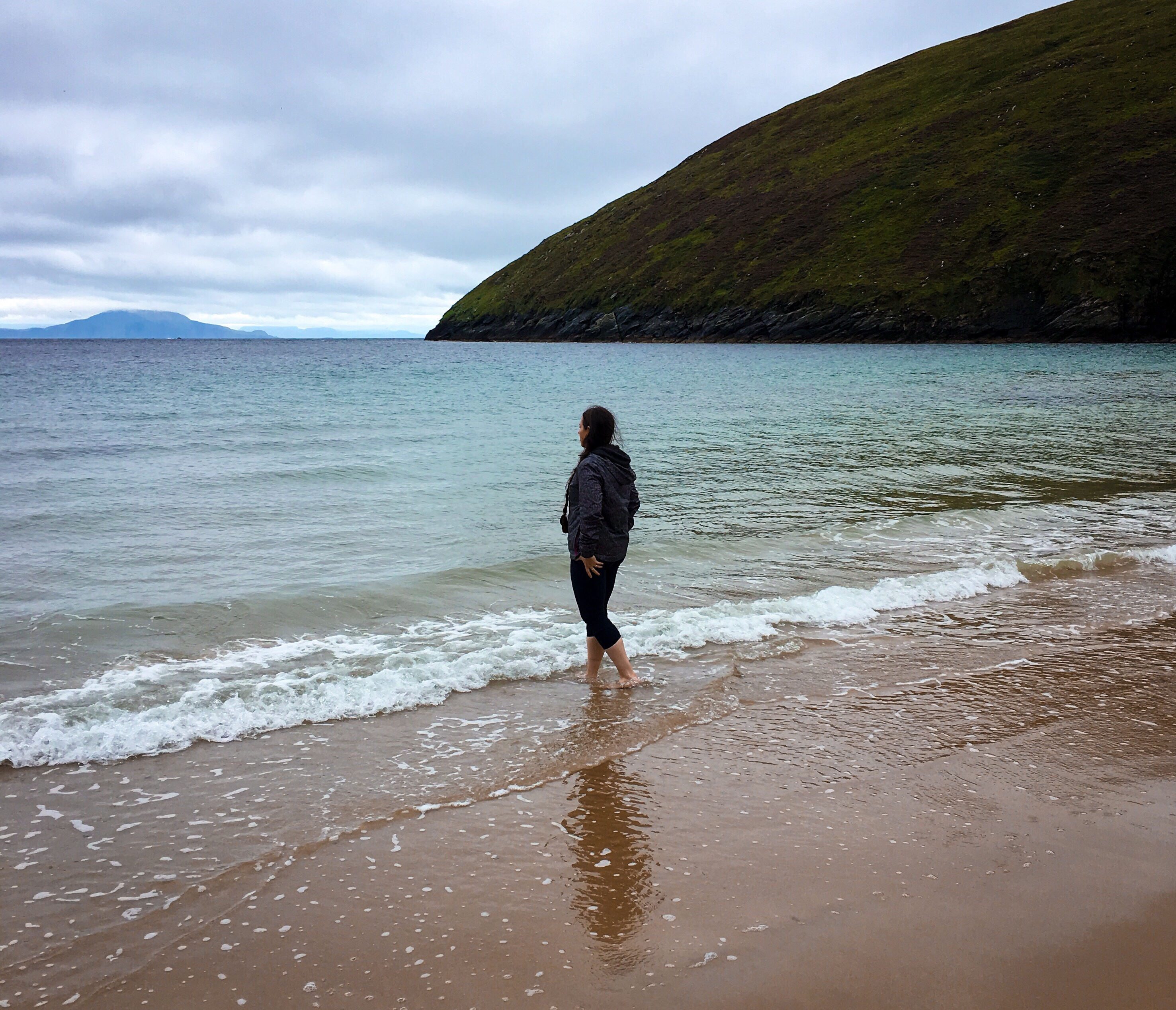 Blythe standing on the beach at Achill Island, Ireland.