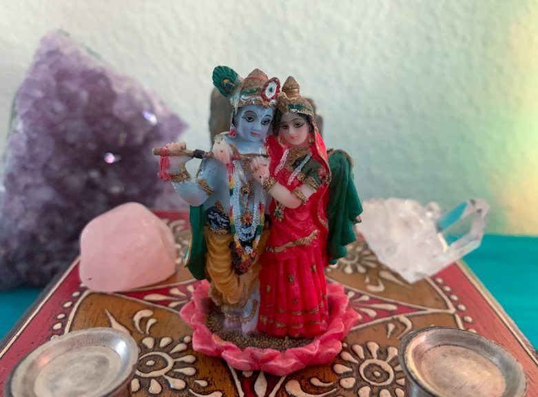 Radha and Krishna standing on a lotus and surrounded by crystals.